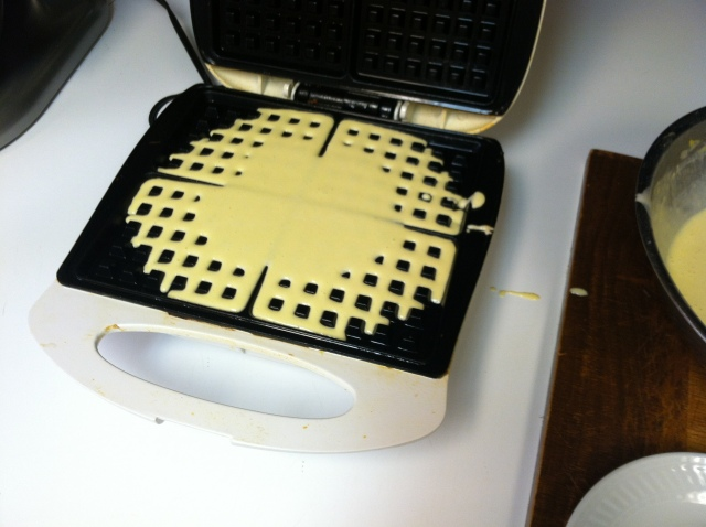 Pour batter on heated waffle maker and close lid