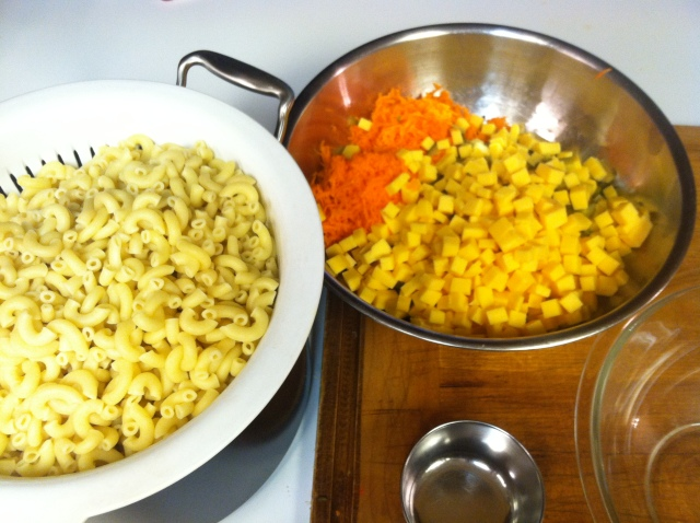 Cook the noodles, prep the red pepper, olives, pickles, green onion, celery, carrots & cheese.